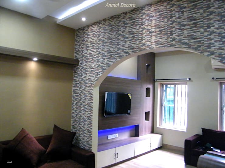 Living room:  Living room by Anmol Decore