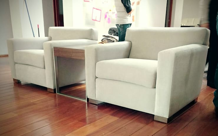 Living room by Estilo en muebles,