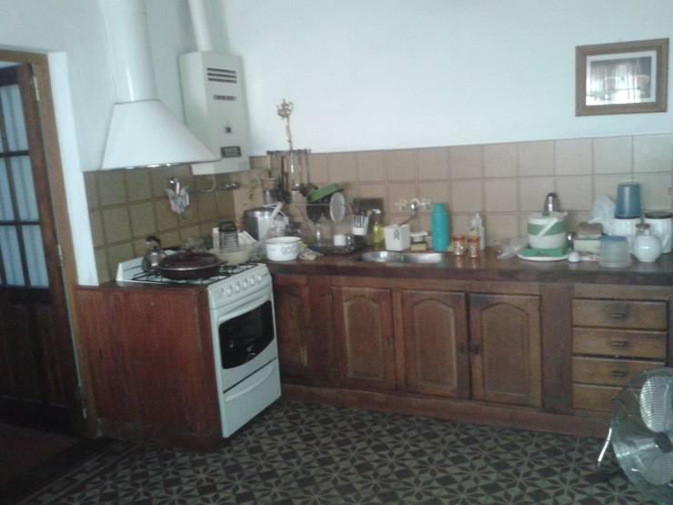 proyecto de cocina: Cocinas de estilo  por Arq Mauricio Perdomo