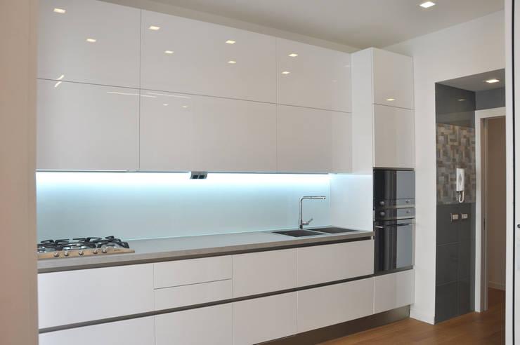 Cocinas de estilo  por evels & papitto - b4architects