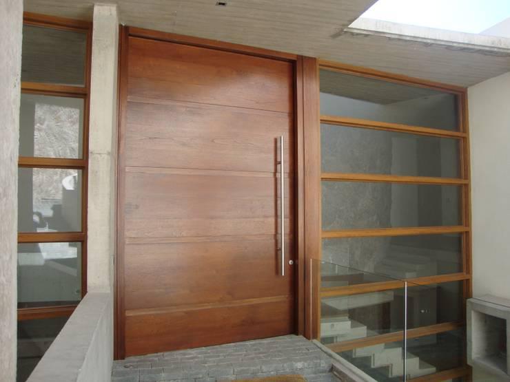 Projekty,  Domy zaprojektowane przez Hernan Arriagada / Arq