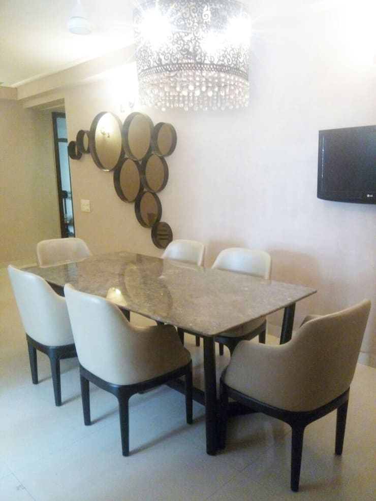 THE EXQUISITE HOME-NOIDA: asian  by FOYER INTERIORS,Asian