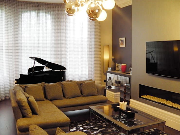 Living room:  Living room by Rethink Interiors Ltd