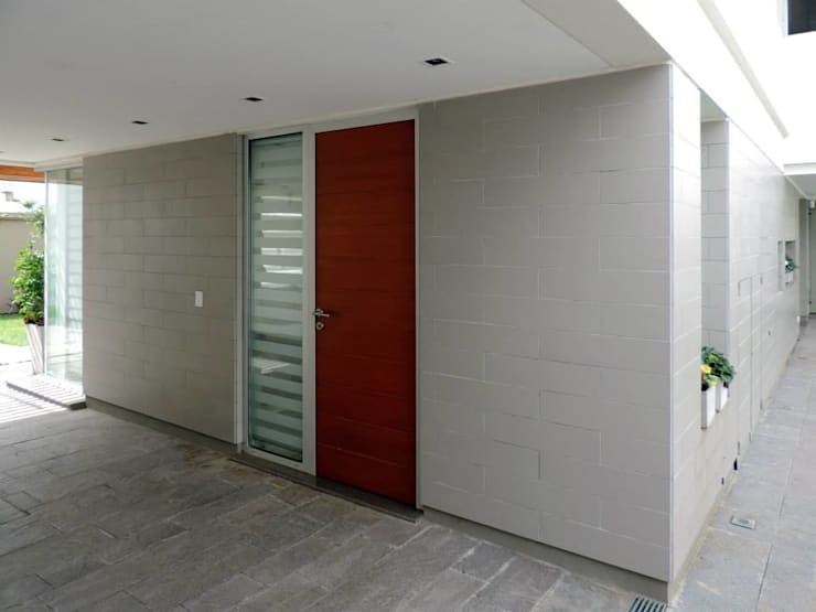 Casa Pueyrredon: Pasillos y recibidores de estilo  por Pablo Langellotti Arquitectura,Moderno