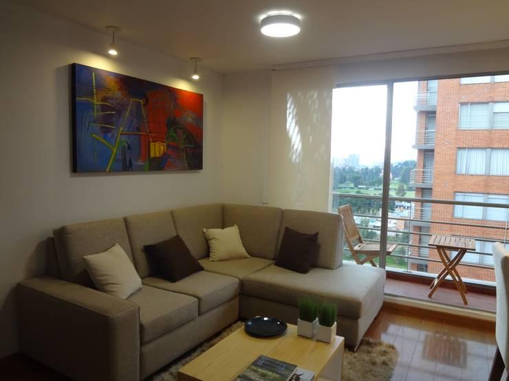 Apartamento Alcaparros Montanar: Salas de estilo  por John Robles Arquitectos, Moderno