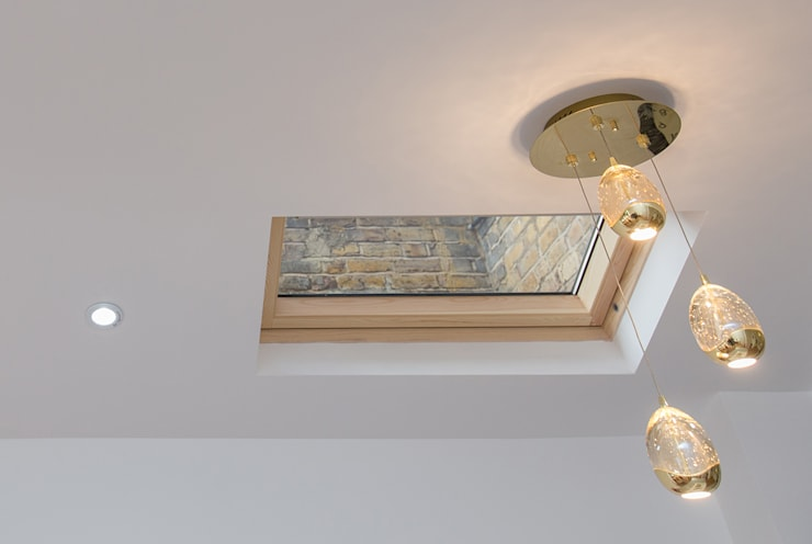 A subtle roof window for that extra light:  Windows  by The Market Design & Build