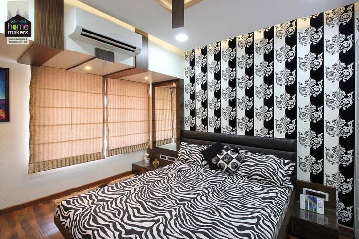 Guest Bedroom: modern Bedroom by home makers interior designers & decorators pvt. ltd.