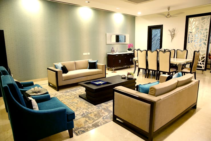 Dining area and visitor's lounge:  Living room by renu soni interior design