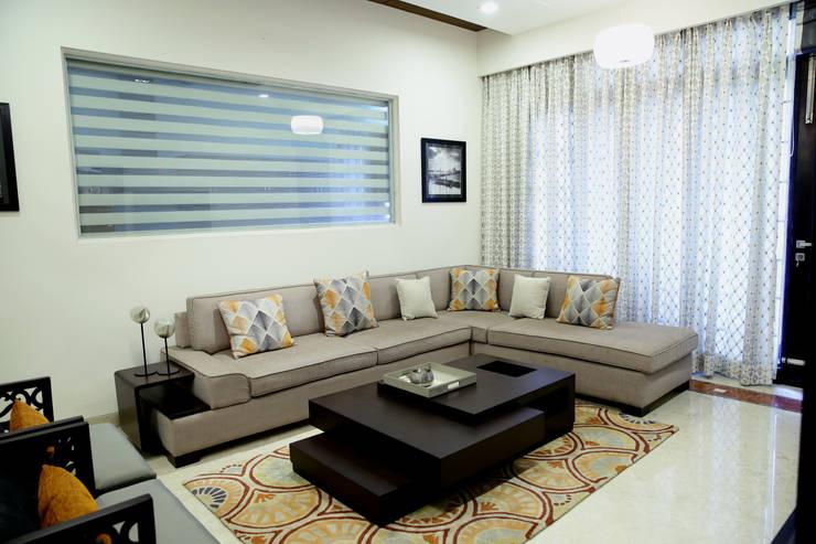 informal Lounge: modern  by renu soni interior design,Modern