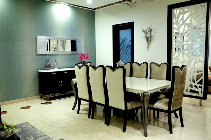 Dining area: modern Dining room by renu soni interior design