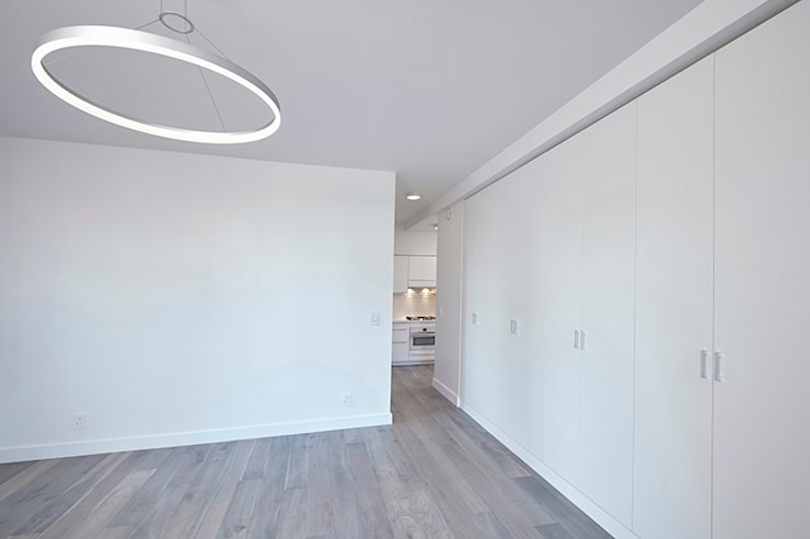 Downtown White on White Apartment:  Living room by Andrew Mikhael Architect,Minimalist