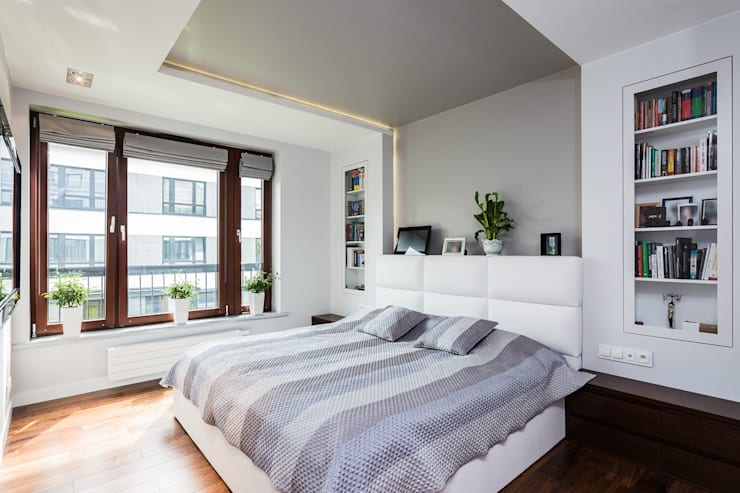 Dormitorios de estilo  por Michał Młynarczyk Fotograf Wnętrz
