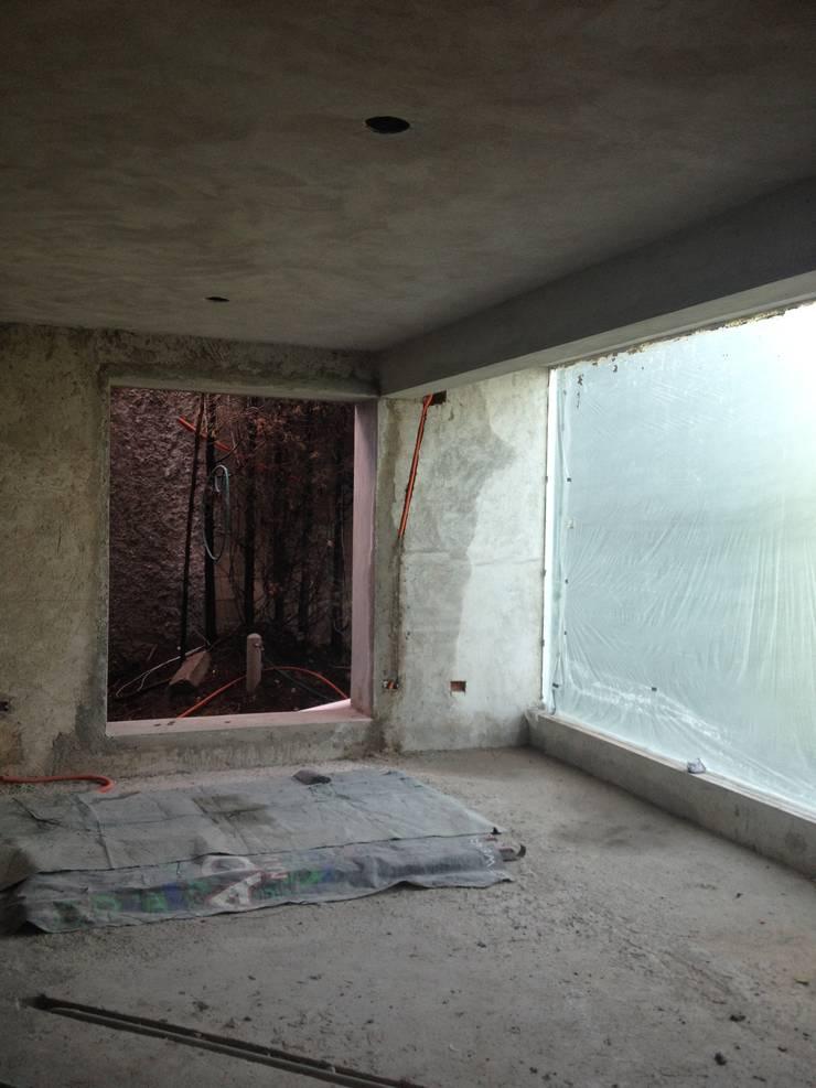 Estancias: Salas de estilo  por Molcajete Arquitectura Interiores Diseño