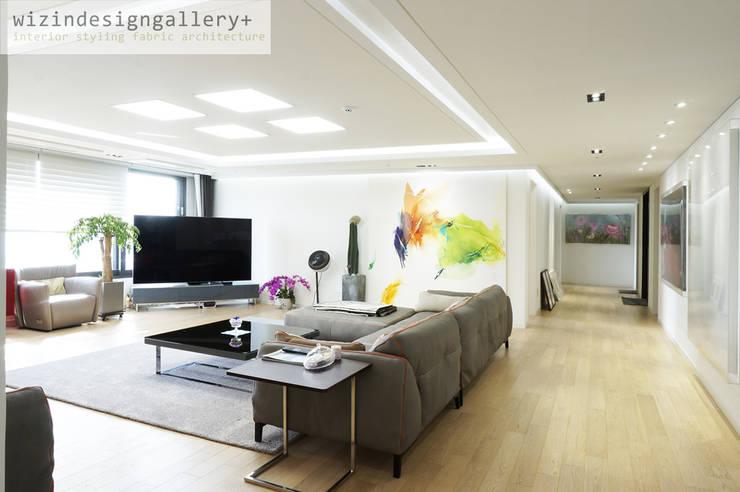반포 래미안퍼스티지, 거실인테리어,거실리모델링: wizingallery의  거실