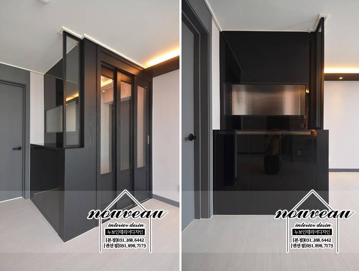 인더스트리얼 컨셉으로 꾸민 34평아파트인테리어: 누보인테리어디자인의  복도 & 현관,모던
