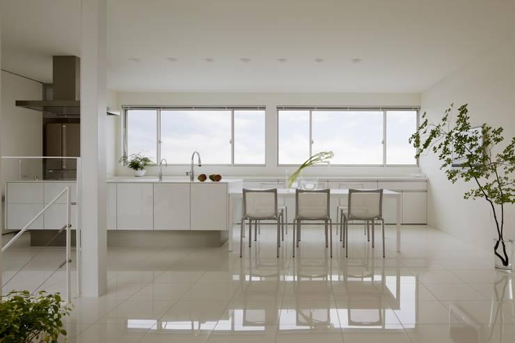 布石の家: SQOOL一級建築士事務所が手掛けたダイニングです。