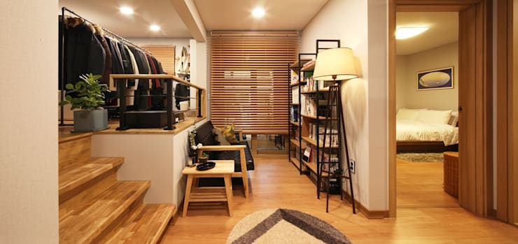 서로 다른 공간의 완벽한 어울림(대전 문창동 주택): 윤성하우징의  서재 & 사무실