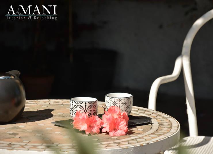 Zen 'n Flowers: Hotel in stile  di A4MANI - Interior & Architecture,