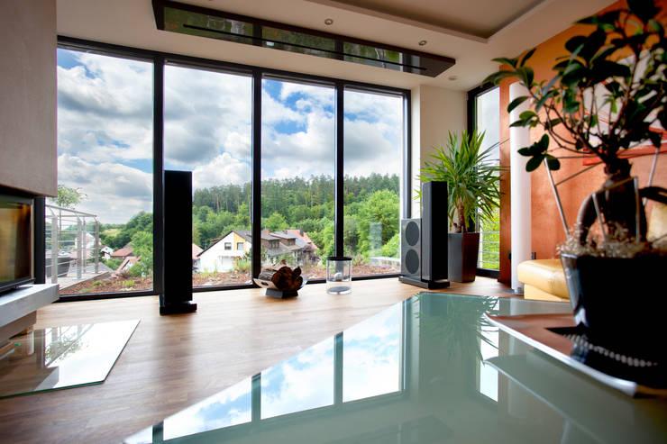 modern Living room by Klaus Geyer Elektrotechnik
