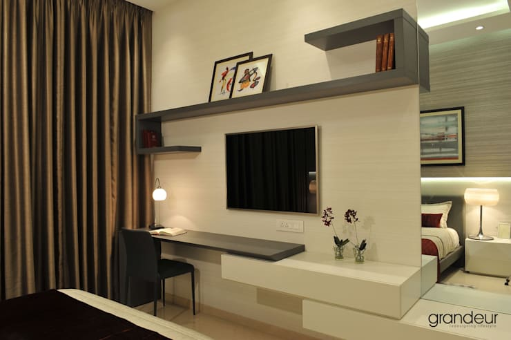 Wall system with desk.:  Bedroom by Grandeur Interiors
