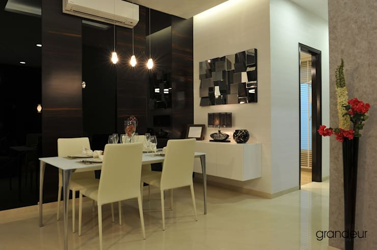 Dining area.:  Dining room by Grandeur Interiors