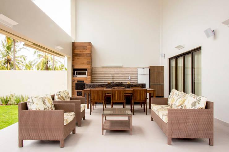 Terrazas de estilo  por Carolina Mota - Arquitetura, Interiores e Iluminação