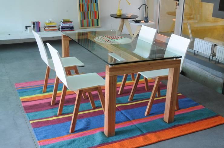 Diana: Paredes y pisos de estilo moderno por Elementos Argentinos