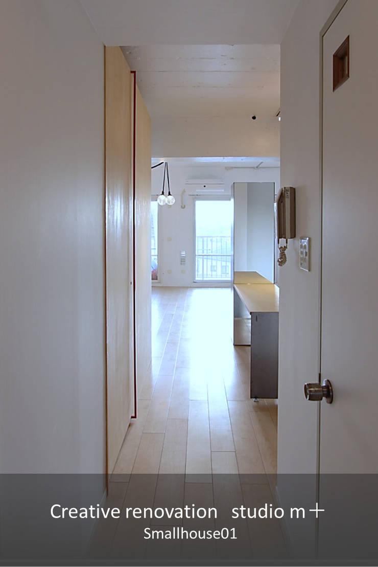 廊下: studio m+ by masato fujiiが手掛けた廊下 & 玄関です。