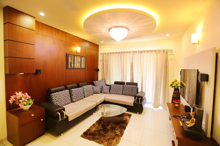 Independent house Manglore..:  Living room by Ashpra Interiors