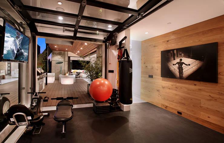 Salle de sport à domicile : Salle de sport de style  par Athletica Design