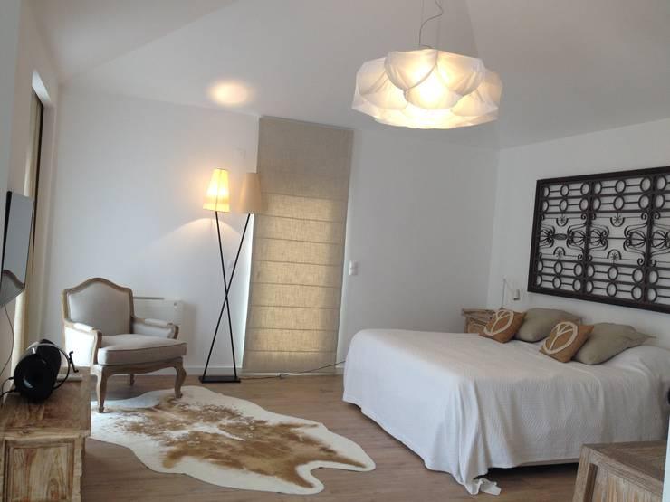 quarto suite: Quarto  por G.R design