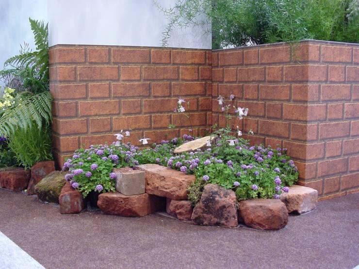 Jardins modernos por (有)ハートランド