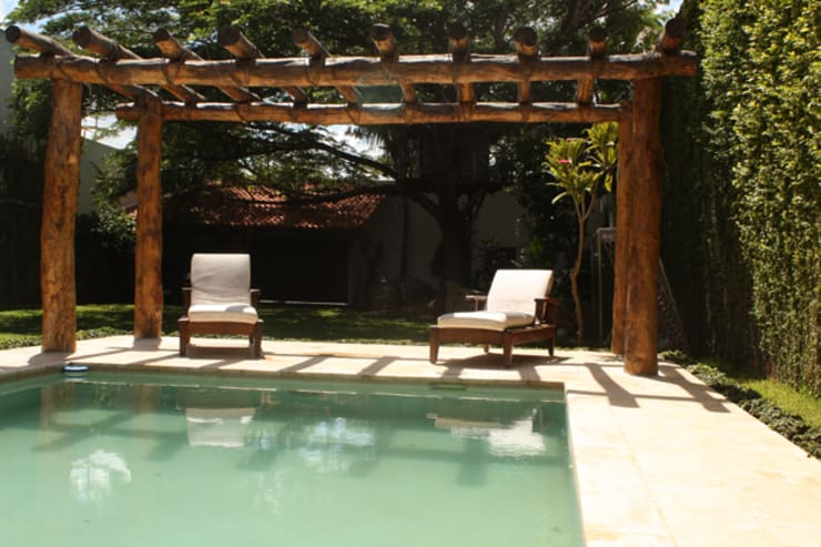 Pool by AIDA TRACONIS ARQUITECTOS EN MERIDA YUCATAN MEXICO, Modern Engineered Wood Transparent