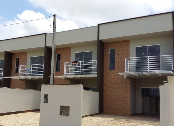 Sobrados Geminados: Casas modernas por mga.arq