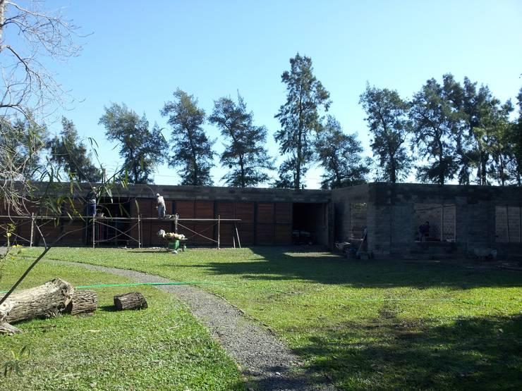 Reforma y ampliación casa Righetti- Rcia. Chaco: Jardines de estilo  por Arq.Rubén Orlando Sosa