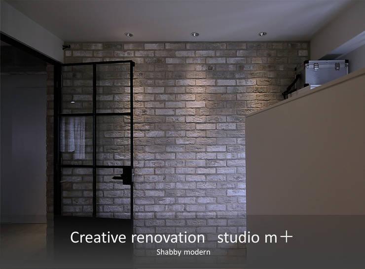 タイル壁 ブリックタイル: studio m+ by masato fujiiが手掛けた壁です。,