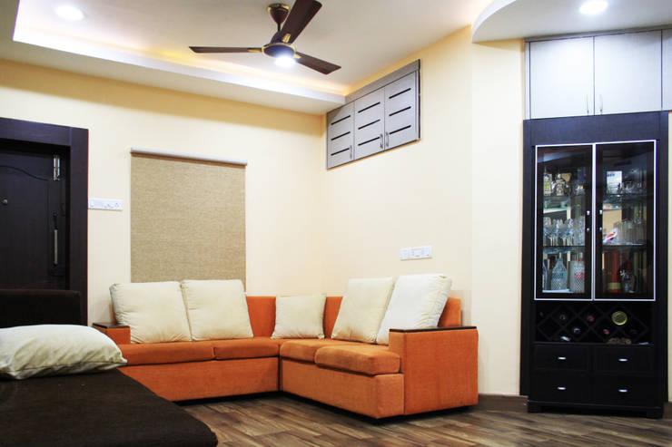 THIRUVANMAYUR BEACH HOUSE..:  Living room by Ashpra Interiors