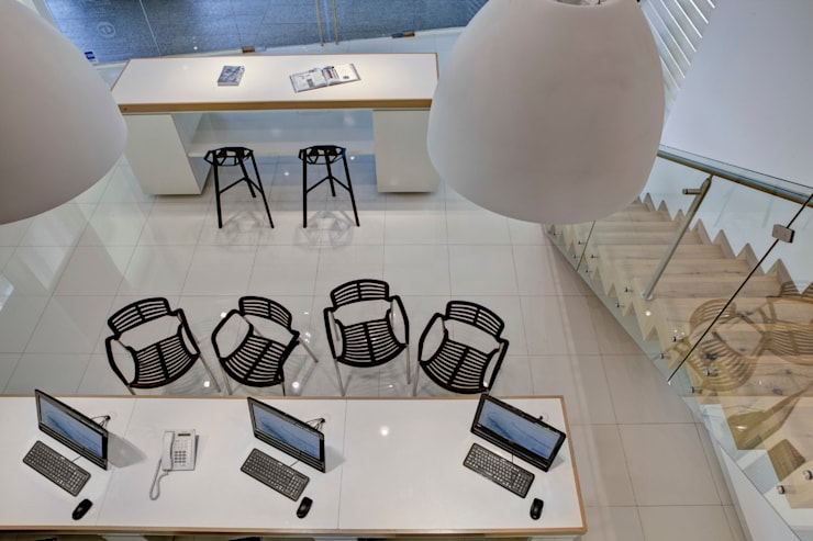 Hunter Douglas Design Center - RIMA Arquitectura: Estudios y oficinas de estilo  por RIMA Arquitectura