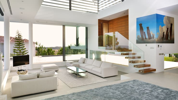 Modern Villa Vale do Lobo: Sala de estar  por Pure Allure Interior
