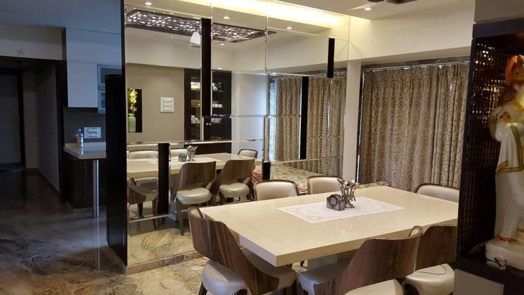 dining:  Dining room by NCA  naresh chandwani & associates,Modern Marble