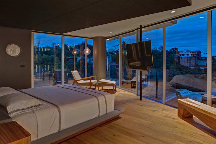 Canelos - RIMA Arquitectura: Recámaras de estilo moderno por RIMA Arquitectura