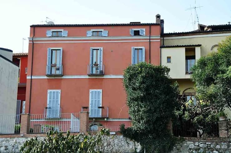 Houses by POMP0NI ASSOCIATI SRL,