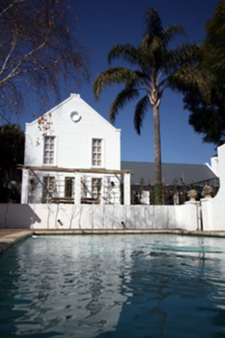 Cape Dutch Guest House:  Hotels by Blue Designs Architectural Designers, Colonial Bricks