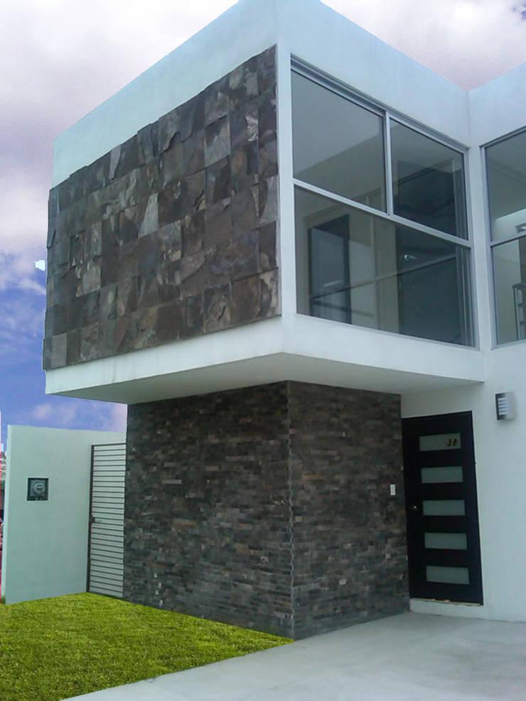 CASA CARDIF 38: Casas de estilo  por CCA arquitectos