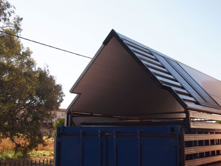 Solar roof:  Houses by A4AC Architects