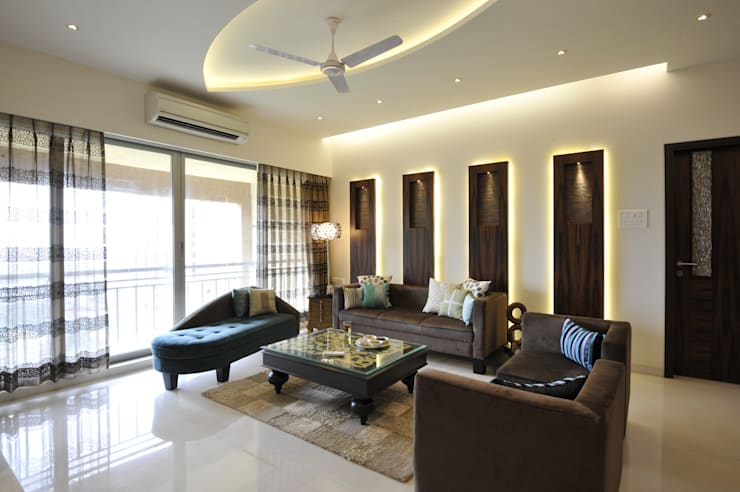 3 Bedroom Mumbai Residence:  Living room by Aum Architects