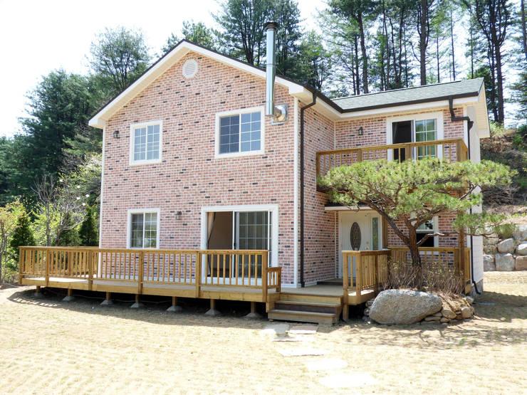 파사드: Timber house의  주택