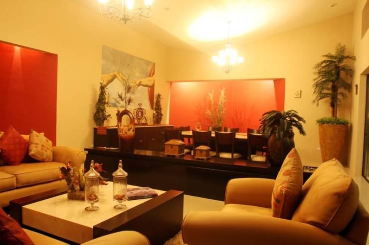Casa OC: Salas de estilo  por AIDA TRACONIS ARQUITECTOS EN MERIDA YUCATAN MEXICO