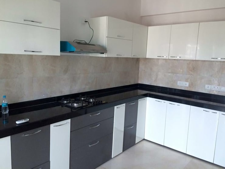 Some Of The Completed Projects:  Kitchen by BEYOND IMAGINATION INTERIORS,Modern