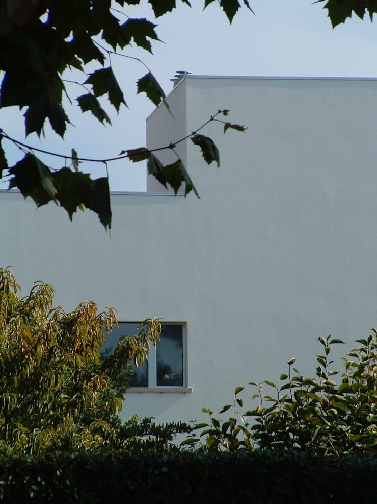 Casa Melo: Casas  por Lousinha Arquitectos